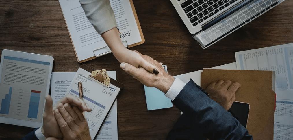 handshake over a work desk